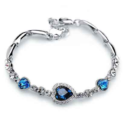 sukkhi trendy valentine heart crystal stone rhodium plated aqua blue bracelet for women (bc80805)